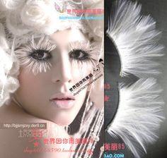 White feather false eyelashes masquerade make-up