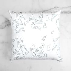 The design of the Infinity Throw Pillow is derived from an original pen drawing that is printed onto a cotton-linen blend fabric. The back side is canvas.