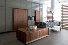 Mix of gloss and wood.  Back painted glass cab doors, wood cabs, etc.  Kitchen | Porcelanosa