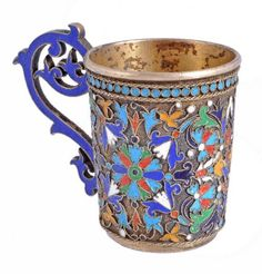 A Russian silver gilt and cloisonne enamel cup.