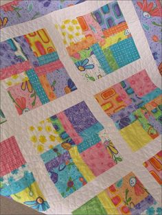 3 times a charm - cute idea for charm packs - good baby quilt