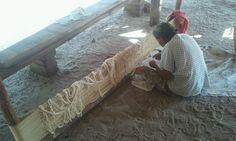Suriname, Indian village Matta. Arowak woman making a hammock