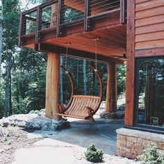 Deluxe Outdoor Swing - Relax in unrivaled style and comfort with our deluxe porch swing. Inspired by the flowing curves of oriental timber frame architecture, this design swings on silent bushings when attached to its optional cantilevered stand.