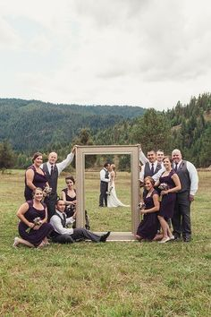 This is a great way to feature the rest of the wedding party in a sweet photo of the bride and groom. #beerwedding