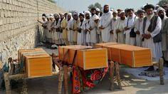 Afghanistan War Casualties | Afghan men pray alongside the coffins of civilians killed in a US-led ...