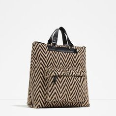 Black and gold ziz zag striped affordable carry on bag perfect for light travel. | essence.com