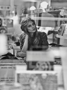 Anna poses in a record store in this black and white image