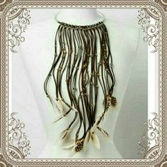 """EXOTIC BOHO COLLAR FEATHER NECKLACE  CALLING  ALL BOHO LOVERS! ADJUSTABLE, METALLIC BAND BOASTS LEATHER STRAPS, APPROXIMATELY """"15 DROP, THAT HAVE ENGRAVED  BOTH GOLD & SILVER BEADS. ❤LOVE THE TRIBAL/BOHO LOOK FINISHED  UP WITH BROWN  & CREAM FEATHERS.❎PLZ DO NOT PURCHASE THIS LISTING❎♒I HAVE 2 AVAILABLE♒, I  WILL MAKE  A SEPARATE  LISTING  FOR YOU TO PURCHASE ( WILL COME NIB) BOTIQUE  Jewelry Necklaces"""