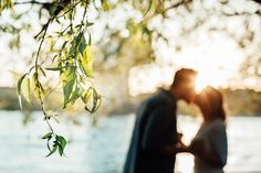 Engagement shooting at sunset ! A wonderful kiss silhouette ... so in love
