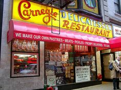 Carnegie Deli, midtown Manhattan.  The mile-high sandwiches, the cheesecake....to die for!