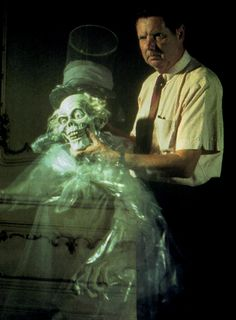 A press photo of Yale Gracey, Disney Imagineer, taken with the Haunted Mansion's infamous Hatbox Ghost, that appeared in papers as early as May 1969. The Hatbox Ghost was removed not long after the Haunted Mansion opened