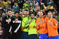 Silver medalists Paolo Nicolai and Daniele Lupo of Italy, gold medalists Alison Cerutti and Bruno Schmidt Oscar of Brazil and bronze medalists Alexander Brouwer and Robert Meeuwsen of Netherlands stand on the podium during the medal ceremony for the Men's Beachvolleyball contest at the Beach Volleyball Arena on Day 13 of the 2016 Rio Olympic Games on August 18, 2016 in Rio de Janeiro, Brazil.
