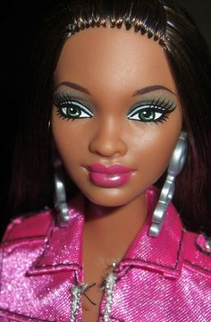 why does this black barbie have to look so ghetto? i'm pissed!