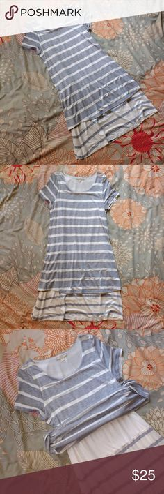 Pleione Gray and Off White T Shirt Dress sz XS Pleione Gray and Off White Striped T Shirt Dress sz XS  Below the knee, layered t shirt dress. Garment is in good pre-owned, pre-worn condition. No rips, holes, or stains.  Please feel free to ask any questions! Pleione Dresses Midi