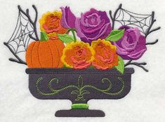 "El 6072  roses and pumpkins in an urn 2 SIZES 	October Blooming Basket	 Product ID:	L6072  Size:	6.75""(w) x 4.86""(h) L6073	3.86""(w) x 2.78""(h)Color Changes:	12  Stitches:	46820	Colors Used:	9"