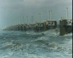 Oosterscheldekering. The Oosterschelde storm surge barrier is a barrier in the Netherlands. It is the largest part of the Delta Works