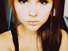 I miss my lip piercing. I'm going to get all of my piercings done again..