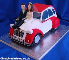 2CV wedding car (W139)    The cake is shaped as a 2CV with the bride and groom sat on the bonnet.