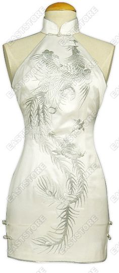 Mandarin collar. Chinese treated frog button. Cut-in shoulder. White with silver piping. Dancing phoenix embroidered. Invisible back center zipper. 2 side slits with 2 frog closures. Fully lined. Mini length.