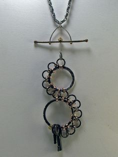 Use the champagne bubbles (other pin) as a steampunk pendent.