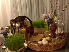 #Haftseen is a tabletop to display Nowruz, an #Iranian new year. Traditionally, The new year is a time when spring equinox happens and day is much brighter. Haft Seen consists of seven items symbolizing specific elements. #Sabzeh ( Green Sprouts) : Rebirth #Samanu( sweet wheat pudding) : affluence #Senjed ( kind of dried fruit) : love #Seer ( garlic) : medicine and health #Seeb ( Apple) : Beauty #Sumac : the color of sunrise #Serkeh ( Vinegar) : patience Happy #Nowruz! Haft Seen, Apple Decorations, Easter Egg Designs, Persian Culture, Christmas Mood, Xmas, Flower Backgrounds, Diy Home Crafts, Handmade Home Decor