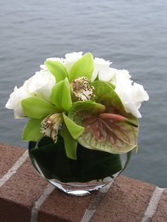 Enchant.     This sweet yet elegant arrangement would make the perfect NYC flower delivery for an employee who has just become a parent.