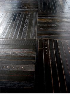 I totally posted about this concept about a year ago.  Old leather belts as flooring!