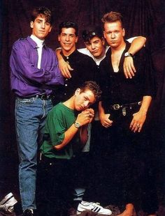 Weird photo of Joe holding Danny's hand.
