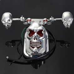 Skull Motorcycle ATV Rear Taillight Turn Signal Brake Plate. Description:  material: Abs Housing & Pc Lens  case Color: Chrome  lens Color: Red  tail Light Color: Red & Warm White  turn Light Color: Amber  voltage: Dc 12v  wattage: Total 20w  tail Light 3 Wires Length: 57.5 Cm / 22.63'  turn Light 2 Wires Length: 30cm / 11.81'    specification:  lens Size(lxwxh): 4'x 7'x 3.74' (10 Cm X 18 Cm X 9.5cm)  screw Hole Diameter: 6mm  screw Hole Spacing: 3cm (1.18')  cable Length: 50cm (19.7')…