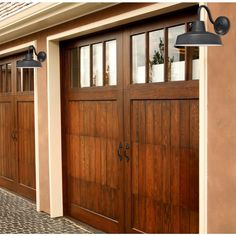 I love these garage doors. They look really nice and more luxurious. It would be amazing to have doors like this on my home. I've always loved wood garage doors. Wooden Garage Doors, Overhead Garage Door, Garage Door Makeover, Wooden Garage, Faux Wood Garage Door, Door Makeover, Garage, Garage Door Types, Overhead Door