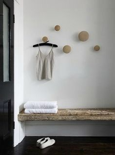 Round wooden hooks & bench for mudroom