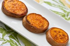 "THESE ARE DELICIOUS!! Sweet potato: Preheat oven to 350*  Slice sweet potatoes ~1/2"" thick  Lightly coat with olive oil + a sprinkling of salt  Bake for 20min [turning once]  Turn heat to 400*  Bake for ~15-20min more [turning once]  You won't even believe what you have just done.  As you puncture through the slightly crunchy browned skin, the center oozes with creaminess.  It is like you puree'd sweet potatoes and infused them back into the potato.  The flavor is equally as amazin..."