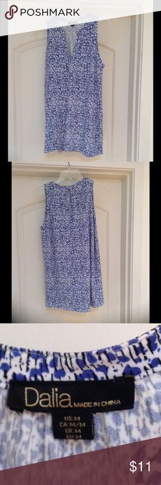 "Gorgeous sleeveless blue/white Dalia top, size M Gorgeous sleeveless blue/white Dalia top, size medium, 28"" from collar to longer back hem, 95% polyester, 5% spandex, machine wash, hang to dry. Dalia Tops"