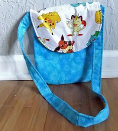 Small Messenger bag made by me using Pokemon Licensed Fabric on flap with turquoise body - teen purse/childrens purse