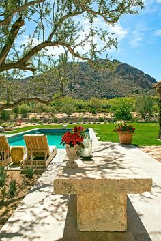 Paradise Valley residence pool and antique stone table looking to Camelback Mountain