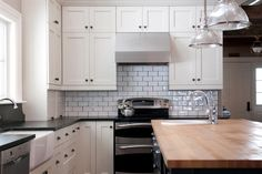 butcher block and black granite countertops with white cabinets - Google Search