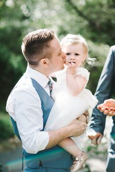 Beautiful photo of father and daughter at wedding - The groom and the flower girl.