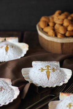 'Tarta de Santiago' Literally meaning cake of St. James, is an an almond cake from Galicia with origin in the Middle Ages. The filling principally consists of ground almonds, eggs and sugar. The top of the pie is usually decorated with powdered sugar, masked by an imprint of the Cross of Saint James which gives the pastry its name.