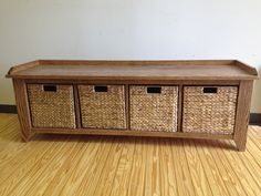 This handcrafted furniture piece provides seating and cubby storage for shoes, etc.
