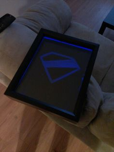 Frosted plexiglass, lit with LED lights on a toggle switch. Modified Superman logo, based on Kingdom Come. #superman #diy #dc