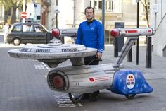 Rob Wixley, decided to show the world his Star Trek style by building this incredible soapbox Starship Enterprise racer in his backyard.He built it for the Red Bull soapbox derby on July 14th in London, and if he can go warp speed in this thing, he'll surely win first place. It took Rob and three of his friends two months to build this soapbox racer inspired by the Starship Enterprise. It oooozes of trekkie creativity, and they way they built it will put a smile on your face.