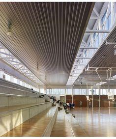The Sports Center in Arteixo designed by the Spanish architect José Ramón Garitaonaindía de Vera uses the rainbow colors to create a stimulating U-glass façade.