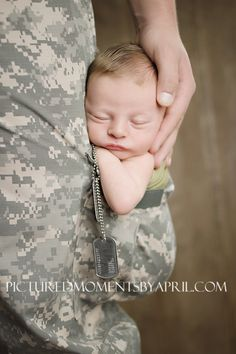 newborn boy sleeping inside the cargo pocket of Army Dad's ACU pants