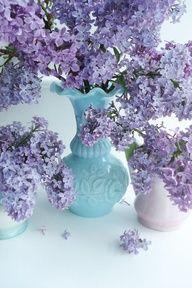 Lavender lilacs in blue, aqua vase
