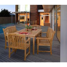 Perfect for poolside or patio entertaining, this Hartford teak outdoor dining set offers comfort and durability in a sleek, stylish package. This 100 percent teak patio dining set includes a rectangular table, two armchairs, and two bench seats.