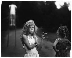 IMMEDIATE - The picture shows a young girl already hooked on cigarettes. It shows the immediate effects of such childhood-ending substances.