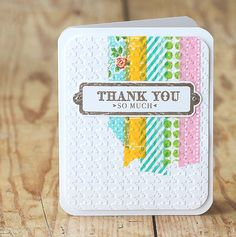 Such a smart idea from Lisa Spangler! She applied washi tape strips to a rectangle panel. Then she ran that bad boy through a die-machine with a houndstooth embossing folder. I love the look!