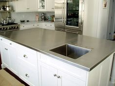 stainless steel countertop with integral sink, faucet not yet installed -- like the clean look of an integral sink