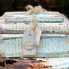 A Bundle of 3 Painted Vintage Books - Shabby-Chic Bound with String, Ive added a padlock and Key The Stack has been painted White and Distressed, Front cover is textured painted white and distressed The books can be seperated to display single, or rearranged in the Stack Pair