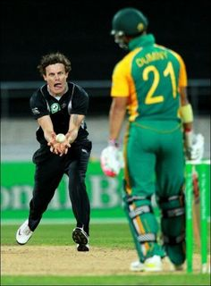 Rob Nicol of New Zealand took a catch off his own bowling to dismiss JP Duminy of South Africa during the One Day International cricket match at Westpac Stadium in Wellington, New Zealand. Love his face! Cricket Time, One Day International, Famous Sports, Cricket Match, West Indian, Take That, Baseball Cards, Fun Time, Bowling